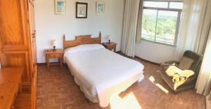 A bed or beds in a room at Casa Macareno