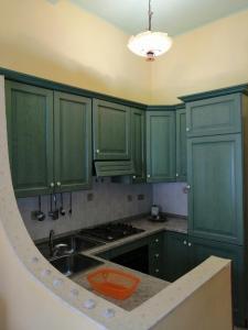 A kitchen or kitchenette at Mediterraneo Appartaments