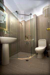 A bathroom at Astron Hotel