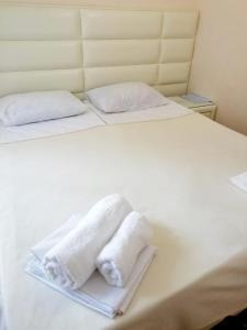 Кровать или кровати в номере Гостевой Дом «Диогрина»