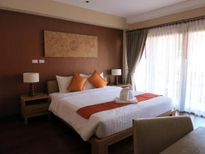 Ein Bett oder Betten in einem Zimmer der Unterkunft Islanda Resort Hotel