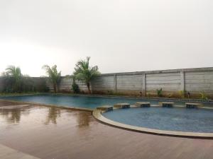 The swimming pool at or near Best Price Studio @ The Enviro Apartment By Travelio