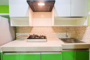 A kitchen or kitchenette at Best Price Studio @ The Enviro Apartment By Travelio