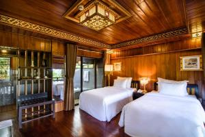A bed or beds in a room at Sankofa Village Hill Resort & Spa