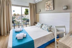 Säng eller sängar i ett rum på Flacalco Hotel & Apartments