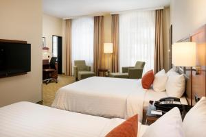 A bed or beds in a room at Courtyard by Marriott Bremen
