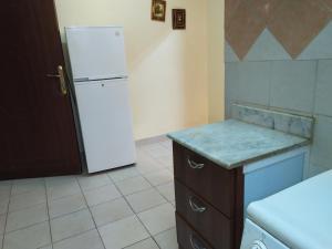 A cozinha ou cozinha compacta de قصر اليمامة للاجنحة الفندقية-فرع حجاب