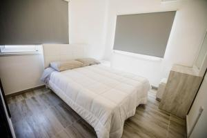 A bed or beds in a room at Twins Apartments