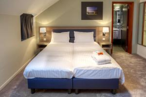 A bed or beds in a room at Azur en Ardenne