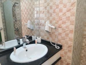 Salle de bains dans l'établissement Sunset Hotel