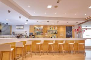 The lounge or bar area at Hotel Maya Alicante