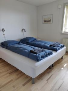 A bed or beds in a room at Vandrehuset 2 og 3