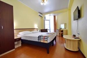 Кровать или кровати в номере Гостевой дом КАКТУС