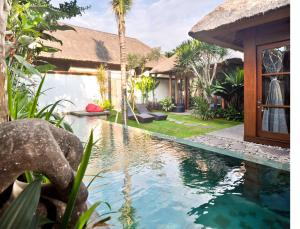 The swimming pool at or near Luwak Ubud Villas and Spa