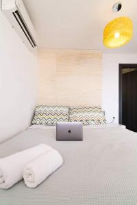 Letto o letti in una camera di Anemos Suite