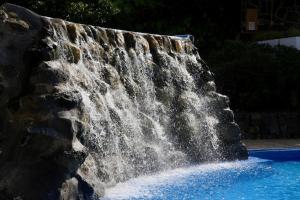 Het zwembad bij of vlak bij Puerto Palace