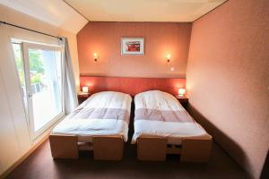 A bed or beds in a room at Hotel Restaurant De La Poste Mulhouse Est