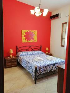 A bed or beds in a room at Mediterraneo Appartaments
