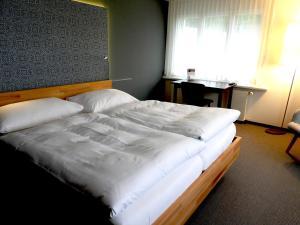 Ein Bett oder Betten in einem Zimmer der Unterkunft Hotel und Seminarhaus Ländli
