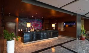 The lobby or reception area at Radisson Blu Pune Hinjawadi