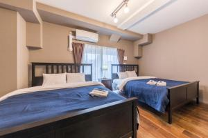 A bed or beds in a room at Minn Juso