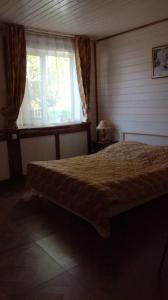 Кровать или кровати в номере Guest House 7 Bereg on Seliger