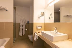 A bathroom at Aimia Hotel