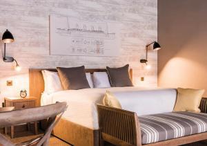 Ein Bett oder Betten in einem Zimmer der Unterkunft Titanic Hotel Liverpool