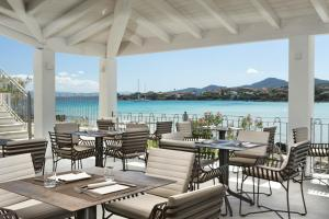 A restaurant or other place to eat at Gabbiano Azzurro Hotel & Suites
