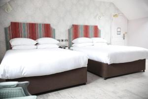 A bed or beds in a room at DoubleTree by Hilton York