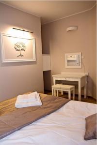 Łóżko lub łóżka w pokoju w obiekcie Hotel Ambasada