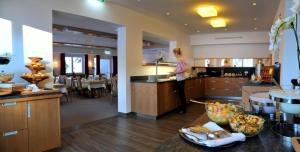 A kitchen or kitchenette at Hotel Hierzegger