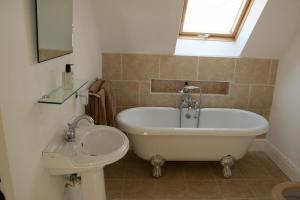 A bathroom at Thatched Cottage