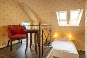 Кровать или кровати в номере Boutique Hotel Belle Epoque