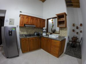 Una cocina o zona de cocina en Fami Hotel Vive Jardin