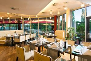 A restaurant or other place to eat at Adrema Hotel