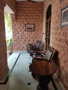 A seating area at Devi Bhawan - A Heritage Hotel