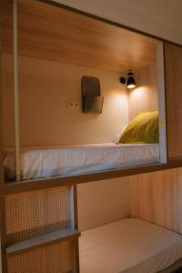A bunk bed or bunk beds in a room at Blai Blai Hostel