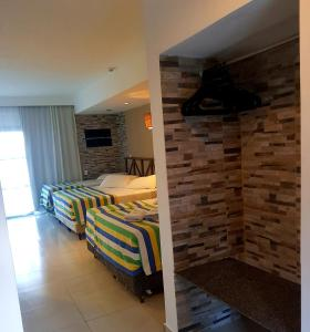A bed or beds in a room at Vila do Mar Natal - All Inclusive