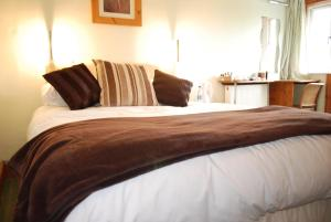 A bed or beds in a room at Madeira Hotel
