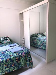 A bed or beds in a room at Apartamento pertinho da UEM/Novo Centro