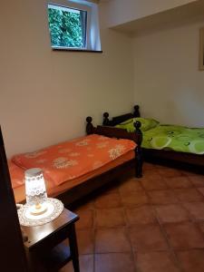 Postelja oz. postelje v sobi nastanitve Apartments Maria