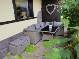 Predel za sedenje v nastanitvi Apartments Maria