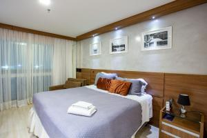 A bed or beds in a room at Flat Vision Hoteleiro Norte