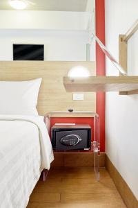 A bed or beds in a room at Red Planet Cagayan De Oro