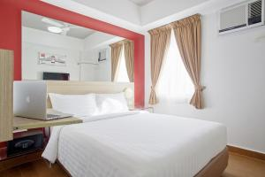 A bed or beds in a room at Red Planet Cagayan De Oro - With Restrictions