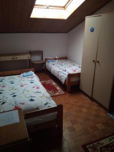 Postelja oz. postelje v sobi nastanitve Gostišče Oddih