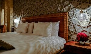 A bed or beds in a room at Hivernage Hotel & Spa