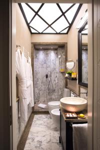 A bathroom at Grand Amore Hotel and Spa