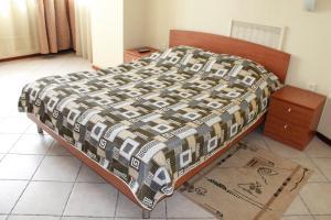 Кровать или кровати в номере Отель Премьера